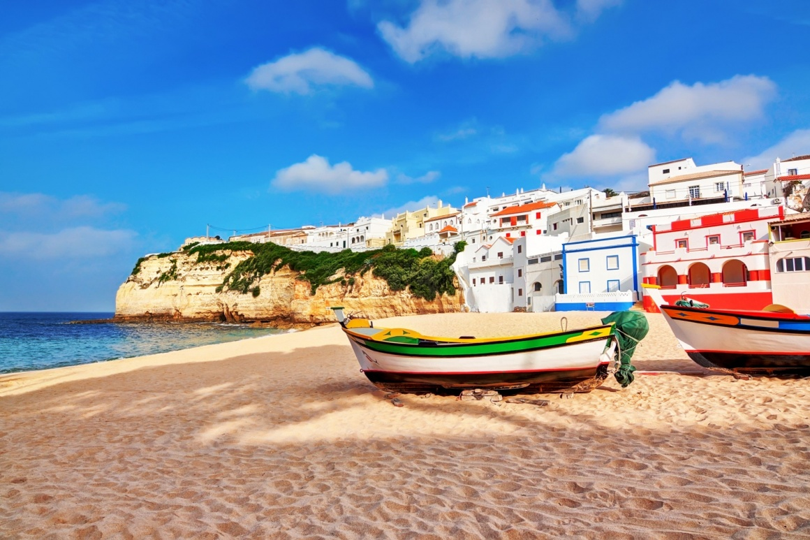 'Portuguese beach villa in Carvoeiro classic fishing boats. Summer.' - Algarve